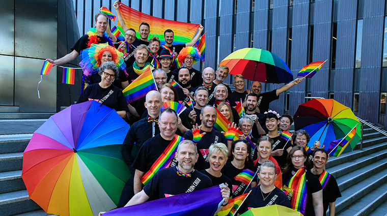 Sydney Gay & Lesbian choir with rainbow flags and umbrellas
