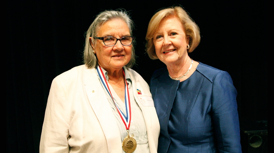 Pat Anderson wins human rights medal, presented by Gillian Triggs. Photo by Matthew Syres